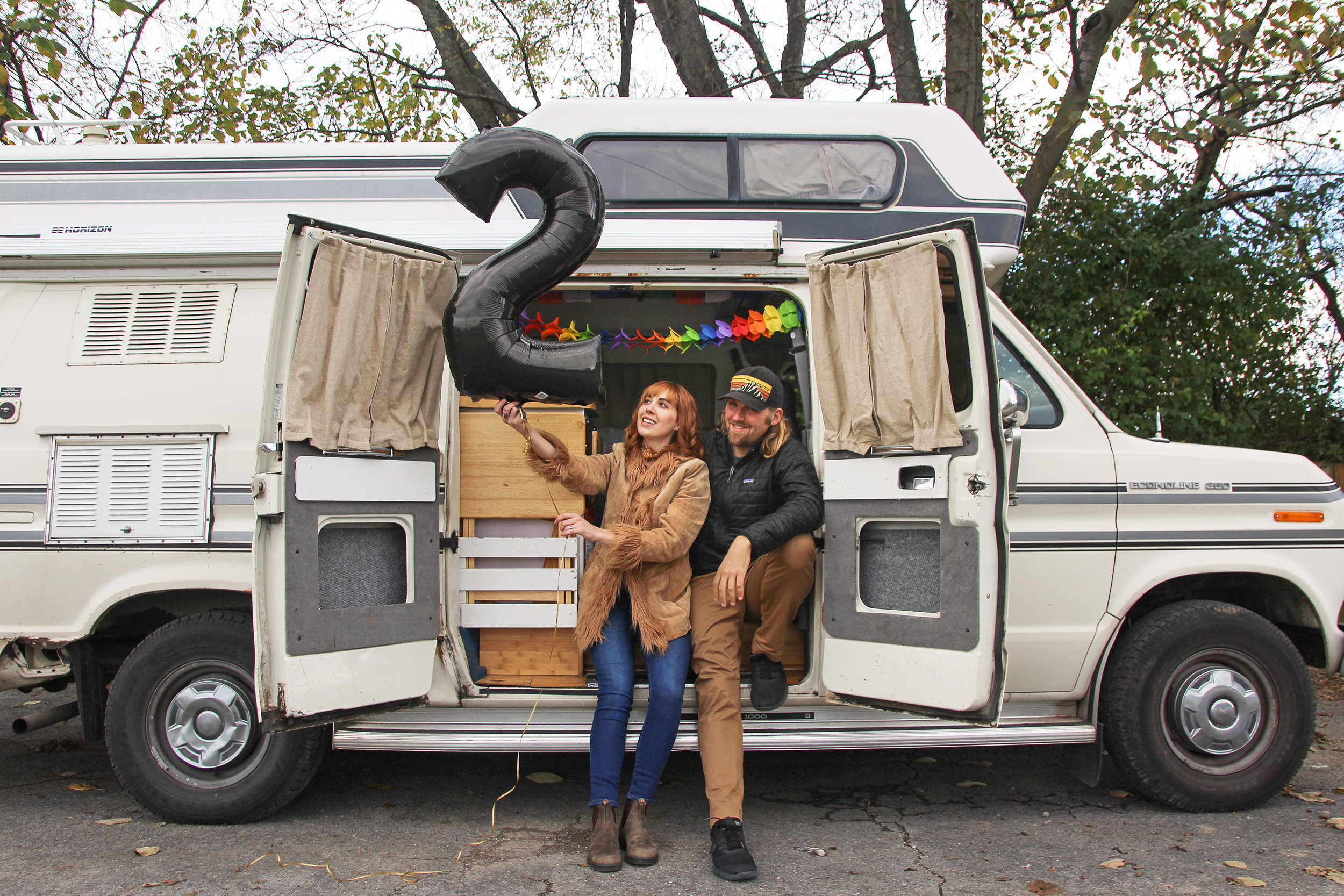 A photo of Savannah & Drew in their rig celebrating two years on the road.