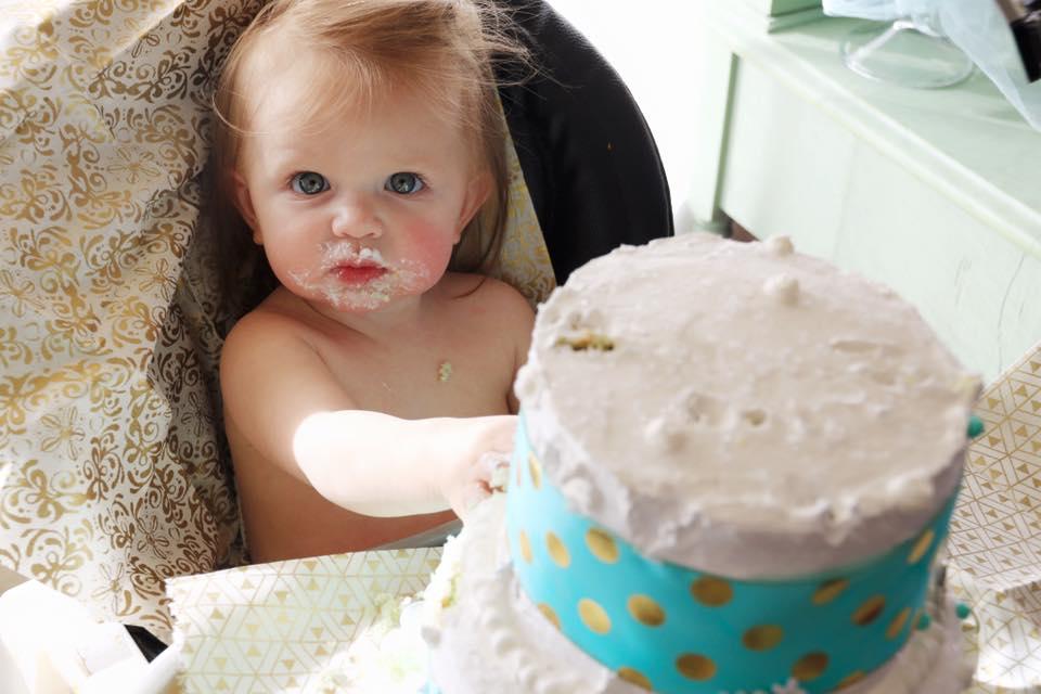Ava sweetly tasting and enjoying her cake!