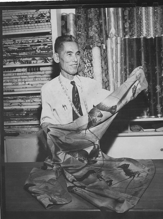 Koichiro Miyamoto, known as Musa-Shiya the Shirtmaker, measures out a length of a beautiful lobster print fabric.