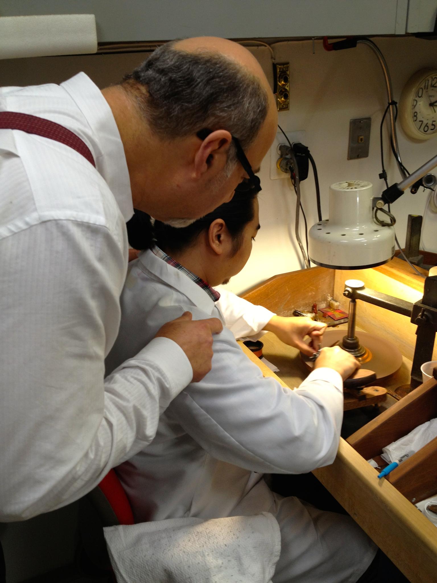 RIchard Orbach and Mr. Shin, gem polisher at work.