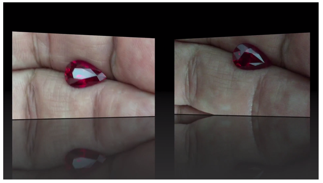 Gem-on-hand-in-motion video under both dim (ballroom) and fluorescent (indoor lit) controlled lighting.