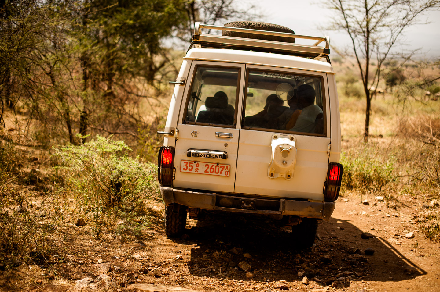 """I have absoute respect for the Toyota Land Cruisers. The """"African package"""": diesel, four-wheel-drive, two spare tires on the roof rack, steel bumpers—front and back. These babies can get you anywhere, and out of anything. On the way to Koshale, Ethiopia. January 23, 2014."""