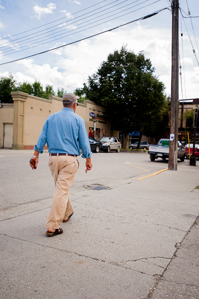 John Baigent, the founder of Partners In The Horn of Africa, walks on toward its office building in Enderby, BC, CANADA on August-17-2013. Photo: Art Zaratsyan