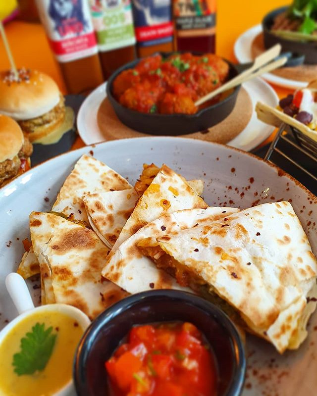 Quesadillas at the Cantina are served with extra 3-cheese queso dip and a generous portion of salsa! Our patios are rocking new fans so swing by and get your Mexican fix today!
