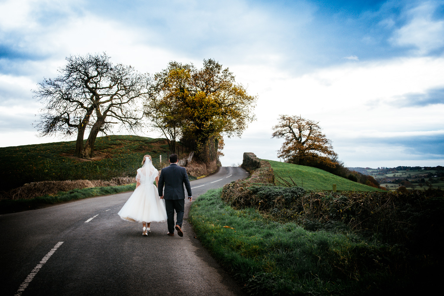 Bride and Groom walking in Derbyshire