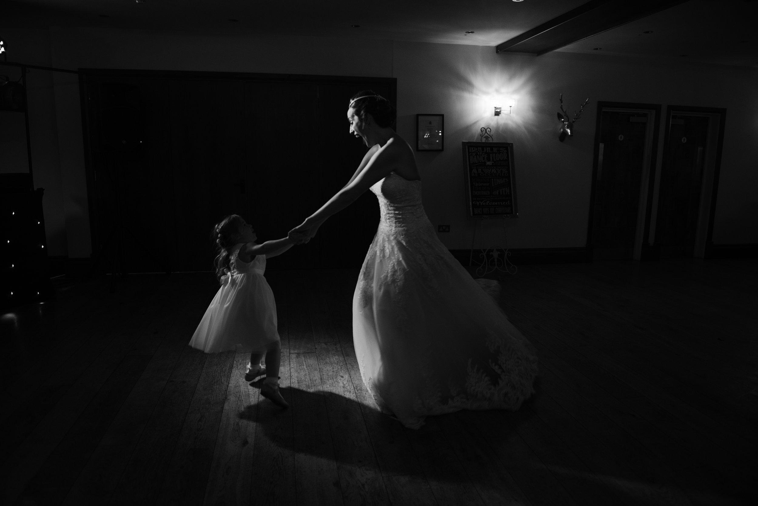 Bride andBridesmaid dancing