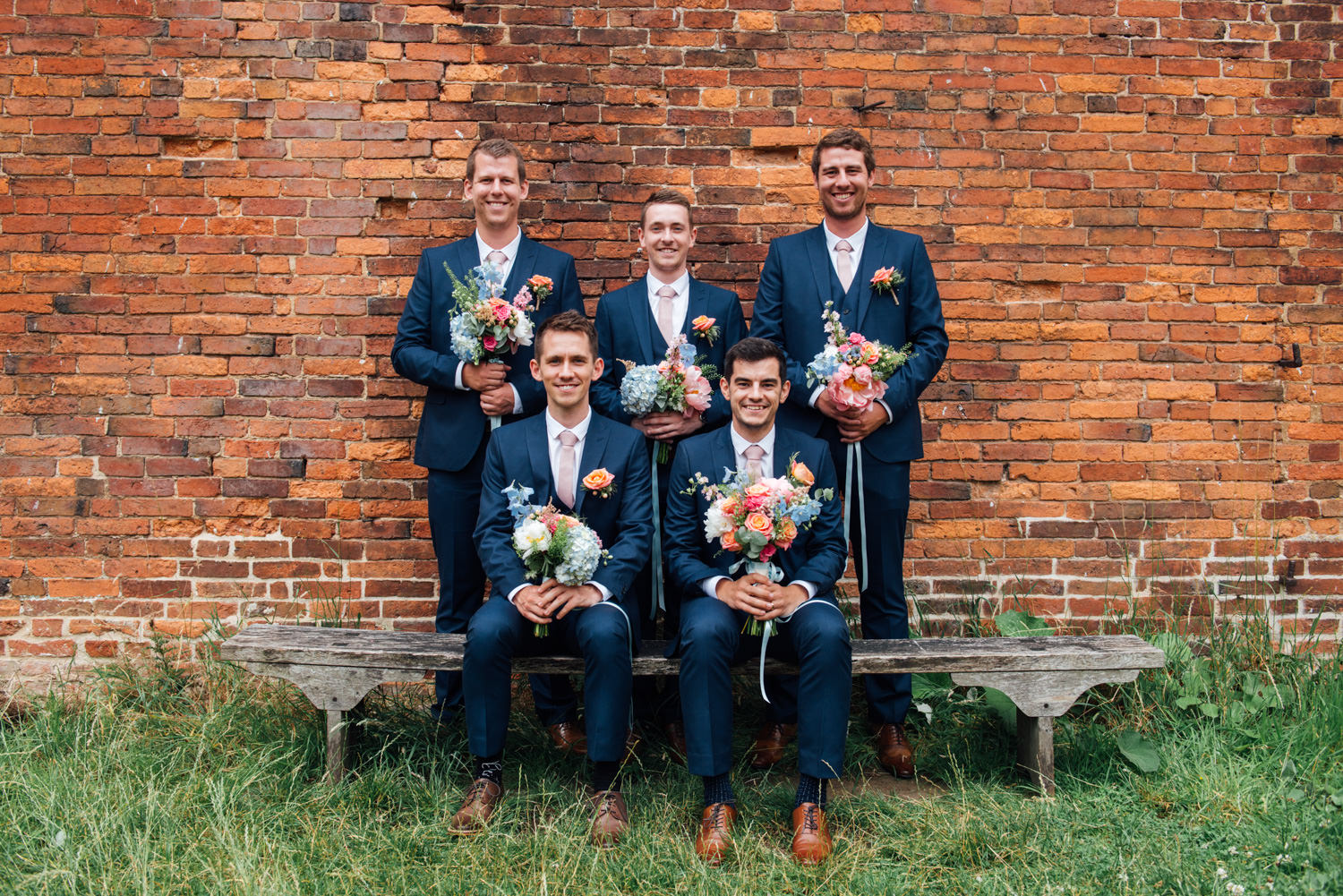 Groomsmen with flowers at Calke Abbey