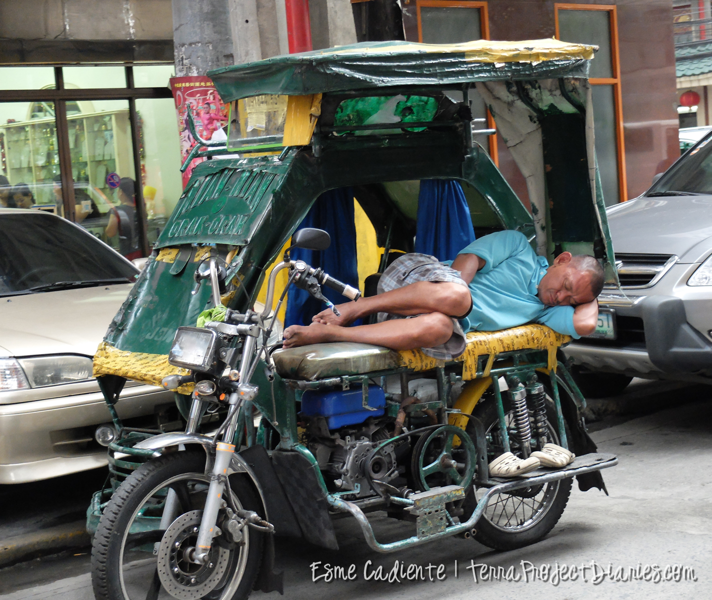 A man takes an afternoon nap on his trike in Chinatown, Manila.