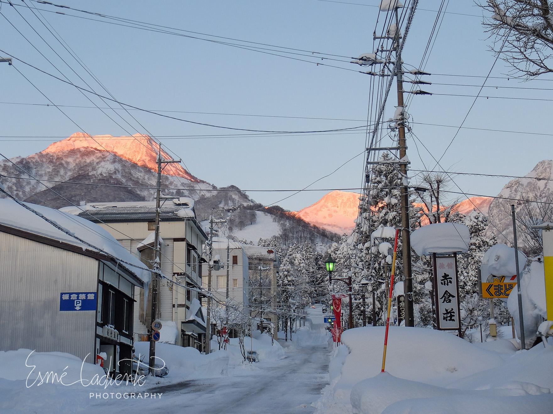 The streets of Myoko Akakura at dawn just as the sun began to rise illuminating Mount Myoko.