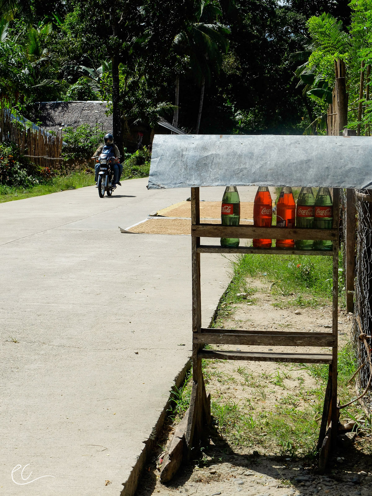 """Coke bottle gas station,Palawan, Philippines. In some remote areas, gas is hard to come by and when you do find it, it usually looks like this. """"Fill it up"""" = 1 coke bottle."""
