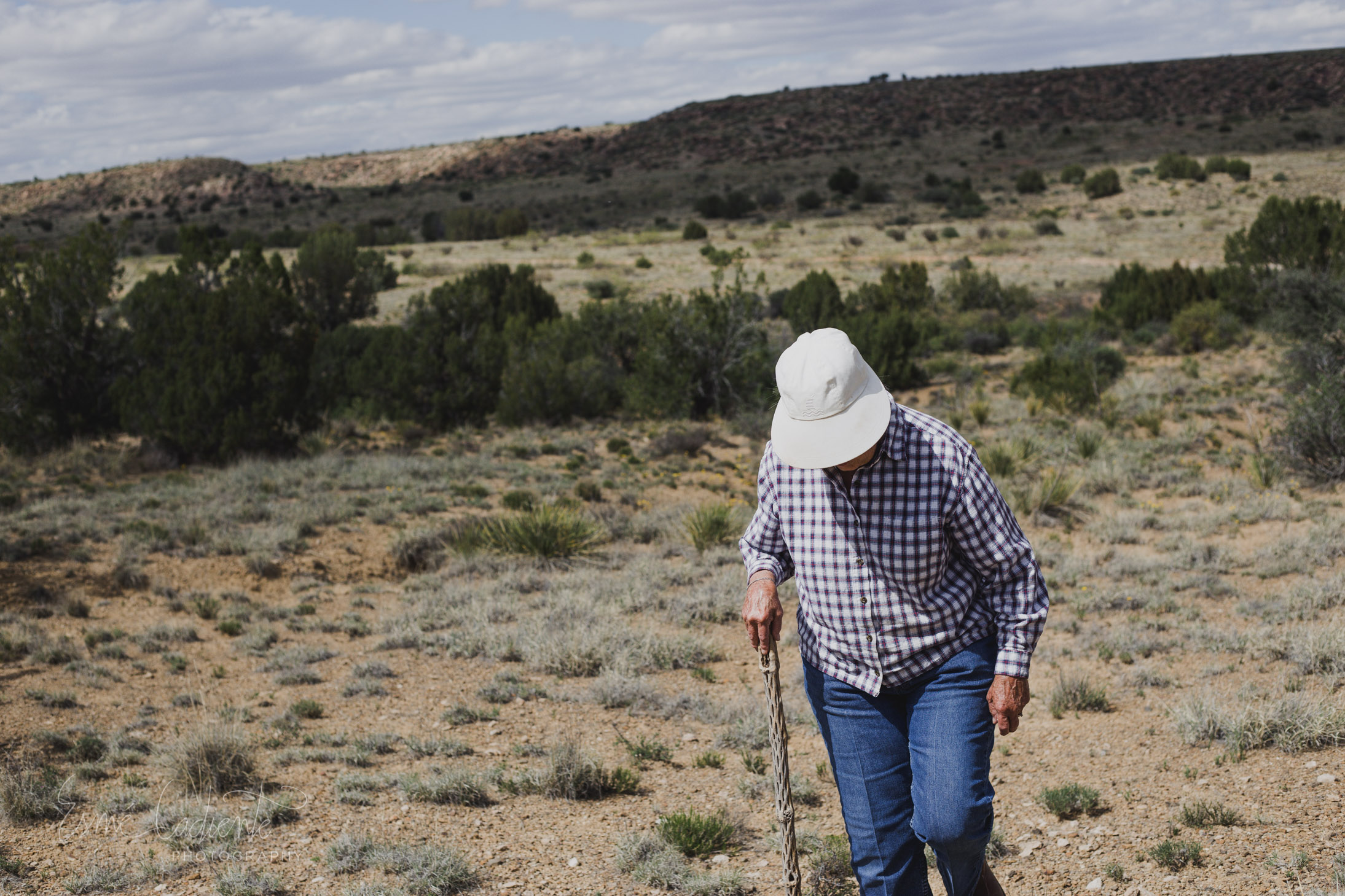"""""""One Woman's Trash is Another Woman's Treasure"""".  My grandmother uses her  cholla  walking stick to poke the ground for arrowheads. With each one she finds, she lets out a youthful proclamation of joy."""