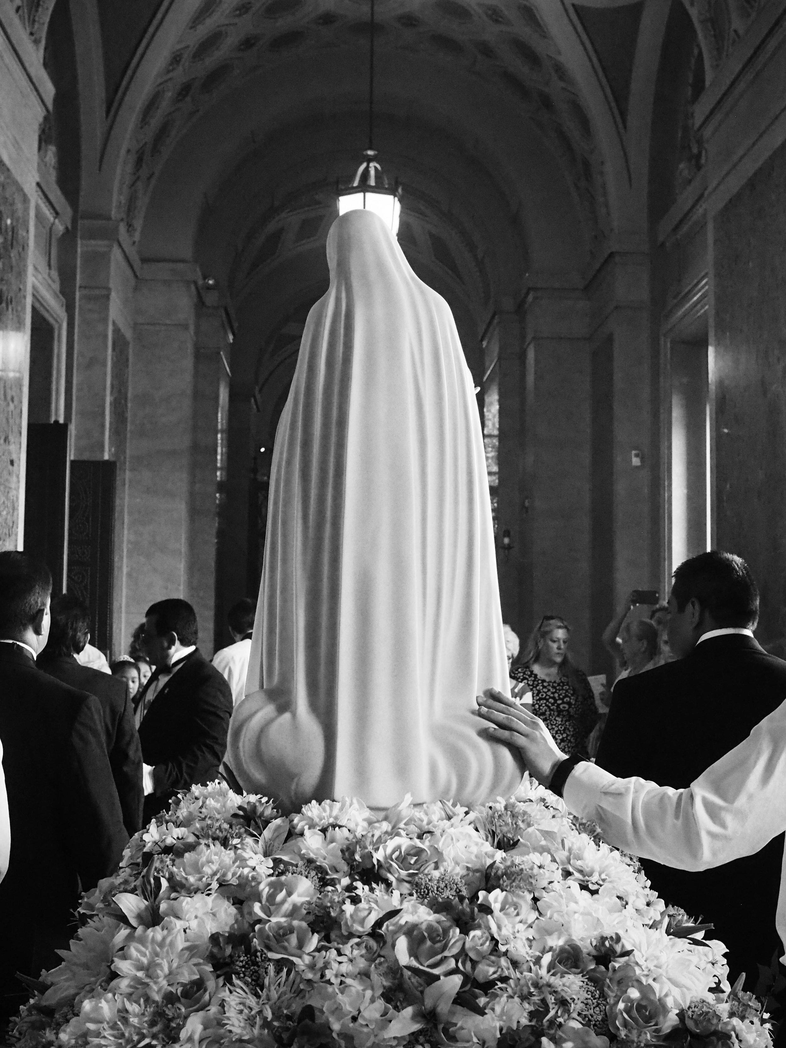 Hand on Mary. Rosary Procession. Saint Paul, MN.