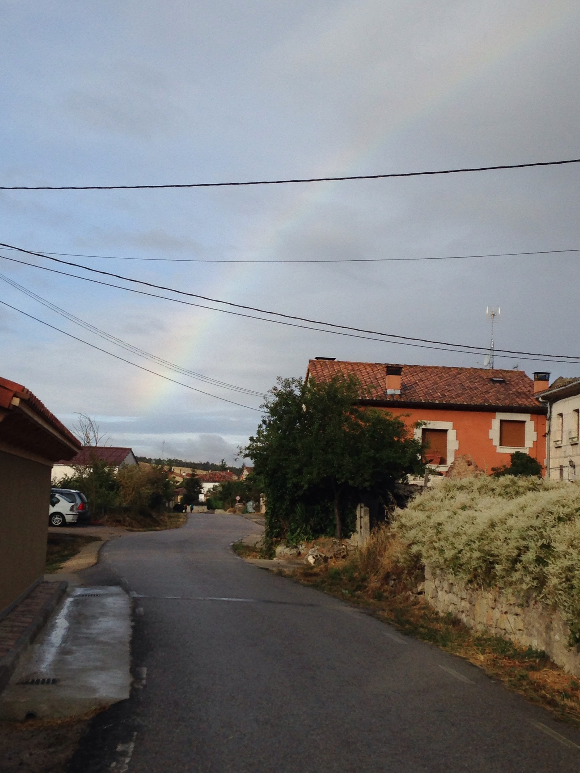 A rainbow shines somewhere over Burgos and the private hotel room I booked