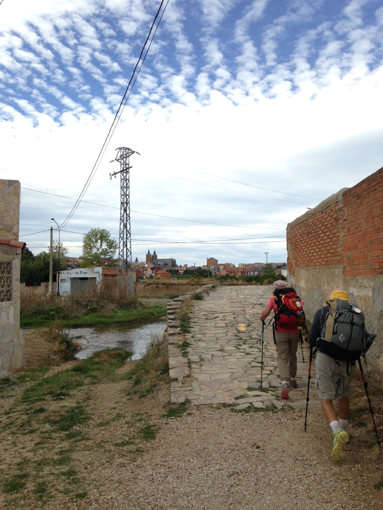 After a long day, weary pilgrims (including me!) on the outskirts of Astorga.  Look at that sky!