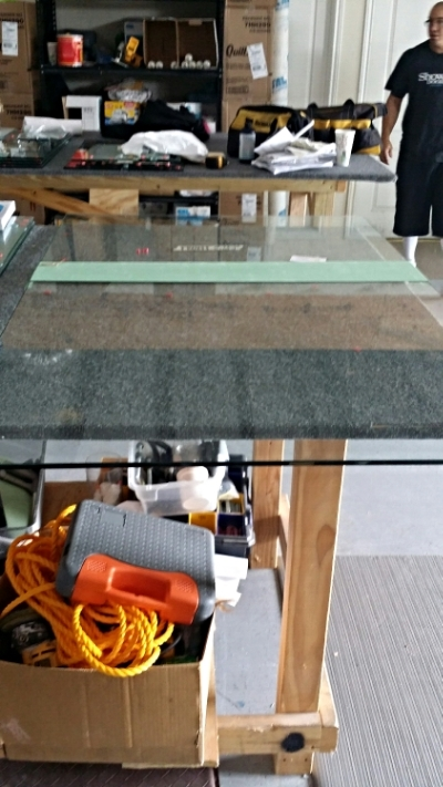 Step 2:  Once the shower door glass is lined out and measured properly, it moves into the booth to be worked on.