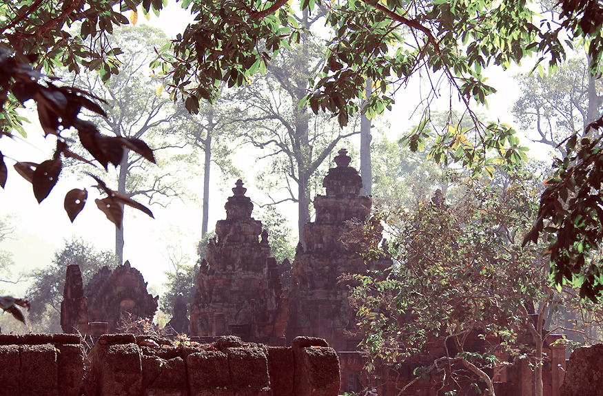 View of Banteay Srei through the encroaching jungle. © Claire Orrell 2014.