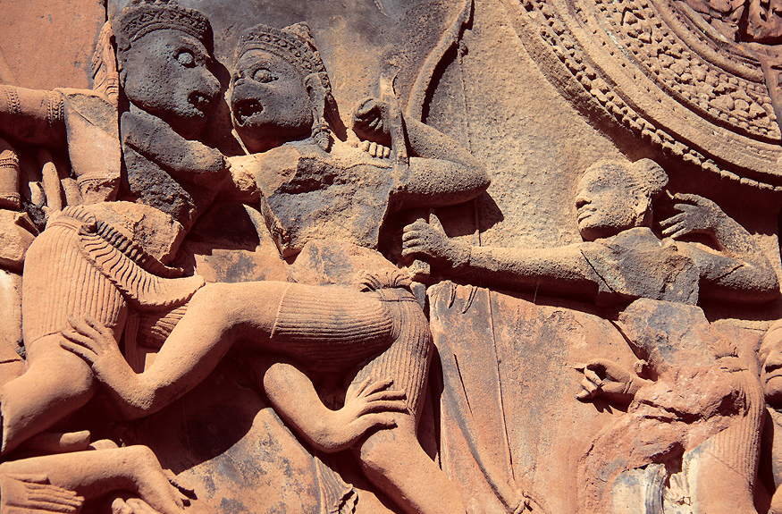 Carving depicting a scene from the Ramayan: Sugrīva lures Vali out of the city by challenging him to a fight. On the right you can see Ram about to shoot and kill Vali with an arrow. © Claire Orrell 2014.