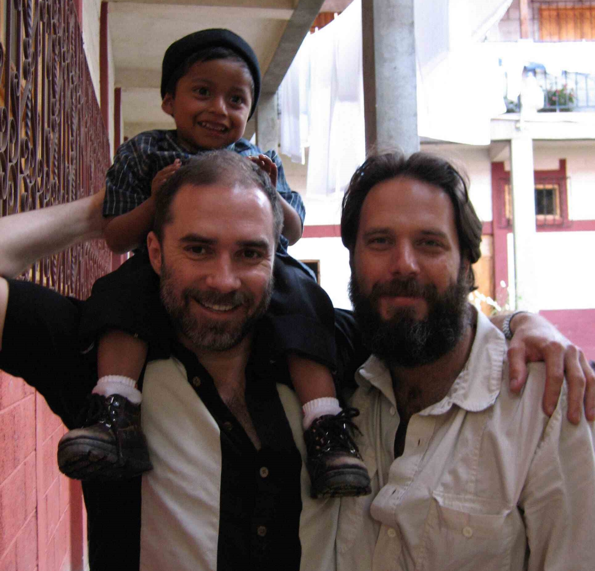RWF Founder Jeff Cotter with volunteer Paul Stankiewicz and Rico at an orphanage in Santa Apalonia, Guatemala.