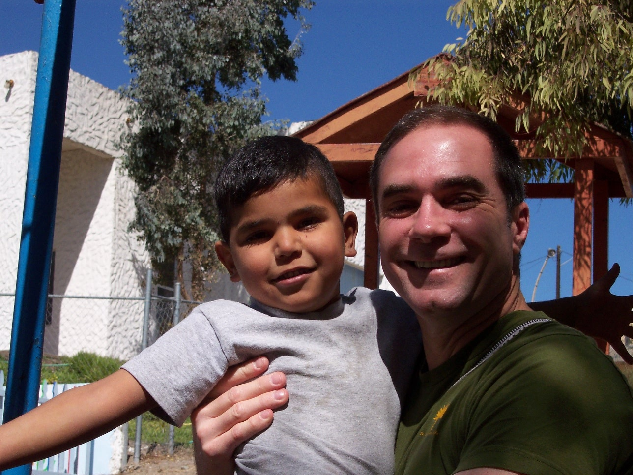 RWF Founder Jeff Cotter visiting orphans in Tijuana, Mexico on a 2008 Bus of Hope trip.