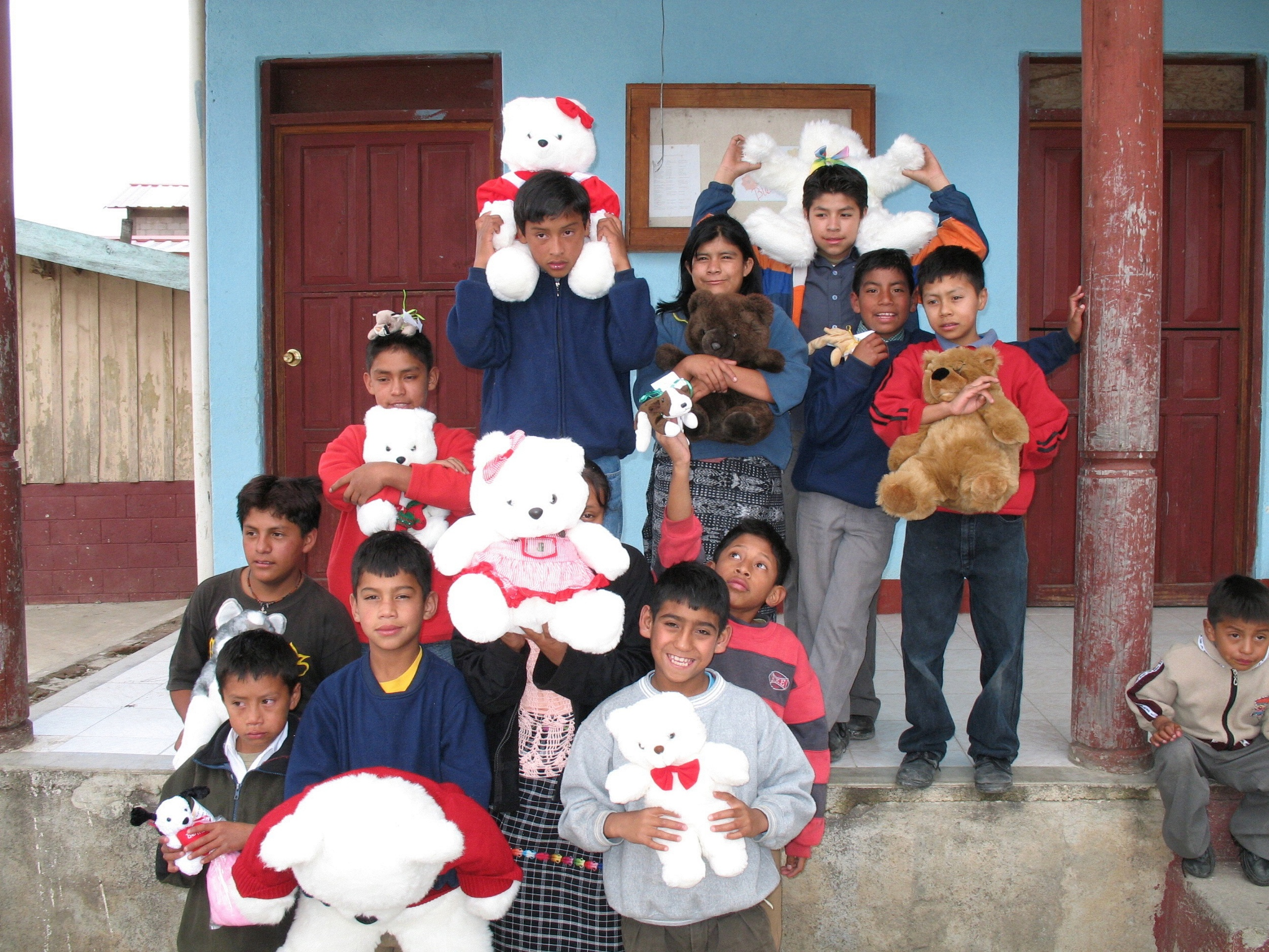 So many children around the world have no toys or stuff animals - these children are holding stuffed animals that RWF delivered to their orphanage.