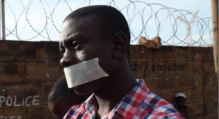 Richard Lusimbo protesting outside of a police office in Kampala, Uganda   (pic)