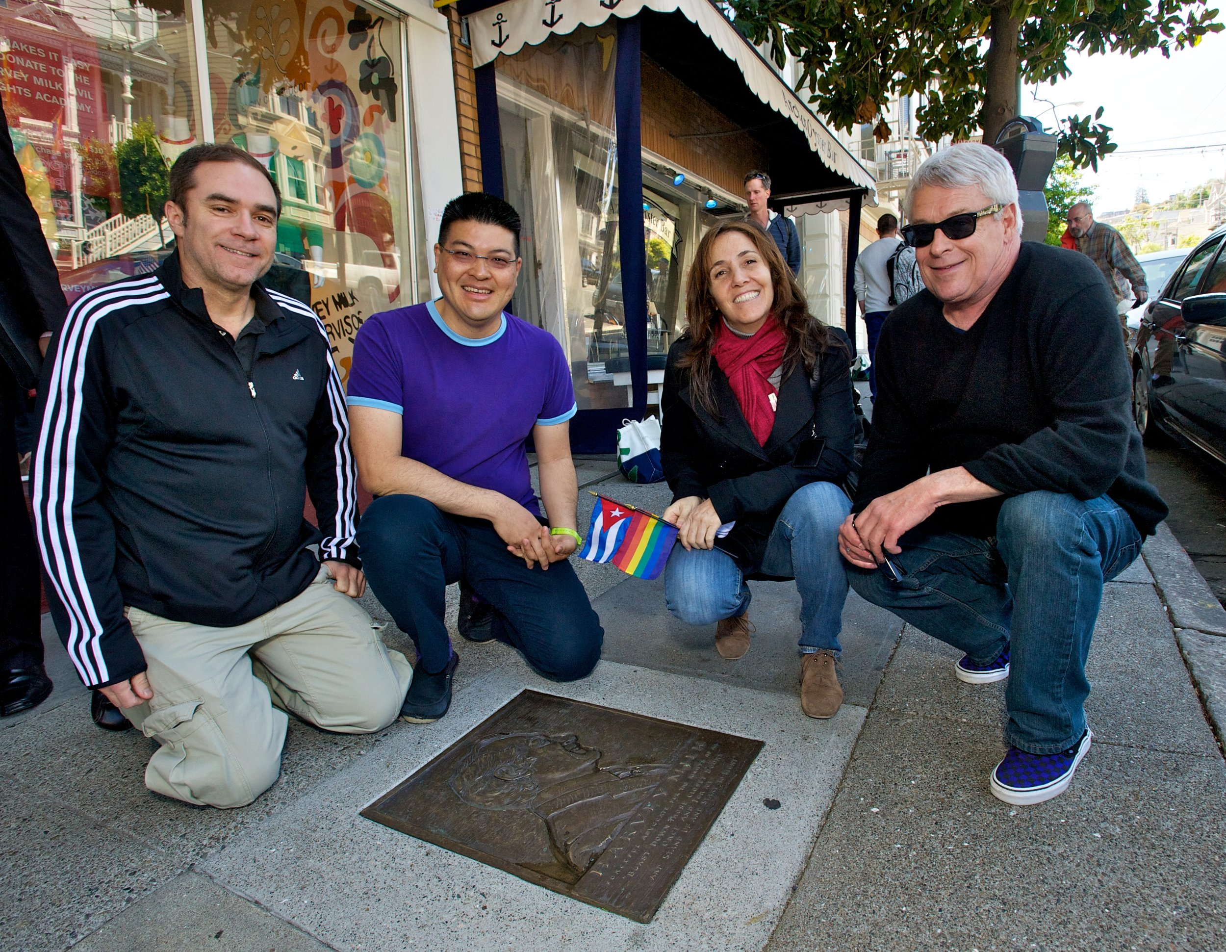 Jeff Cotter, Daniel Bao, Mariela Castro and Cleve Jones visit the Harvey Milk plaque on the Rainbow Honor Walk (2012)