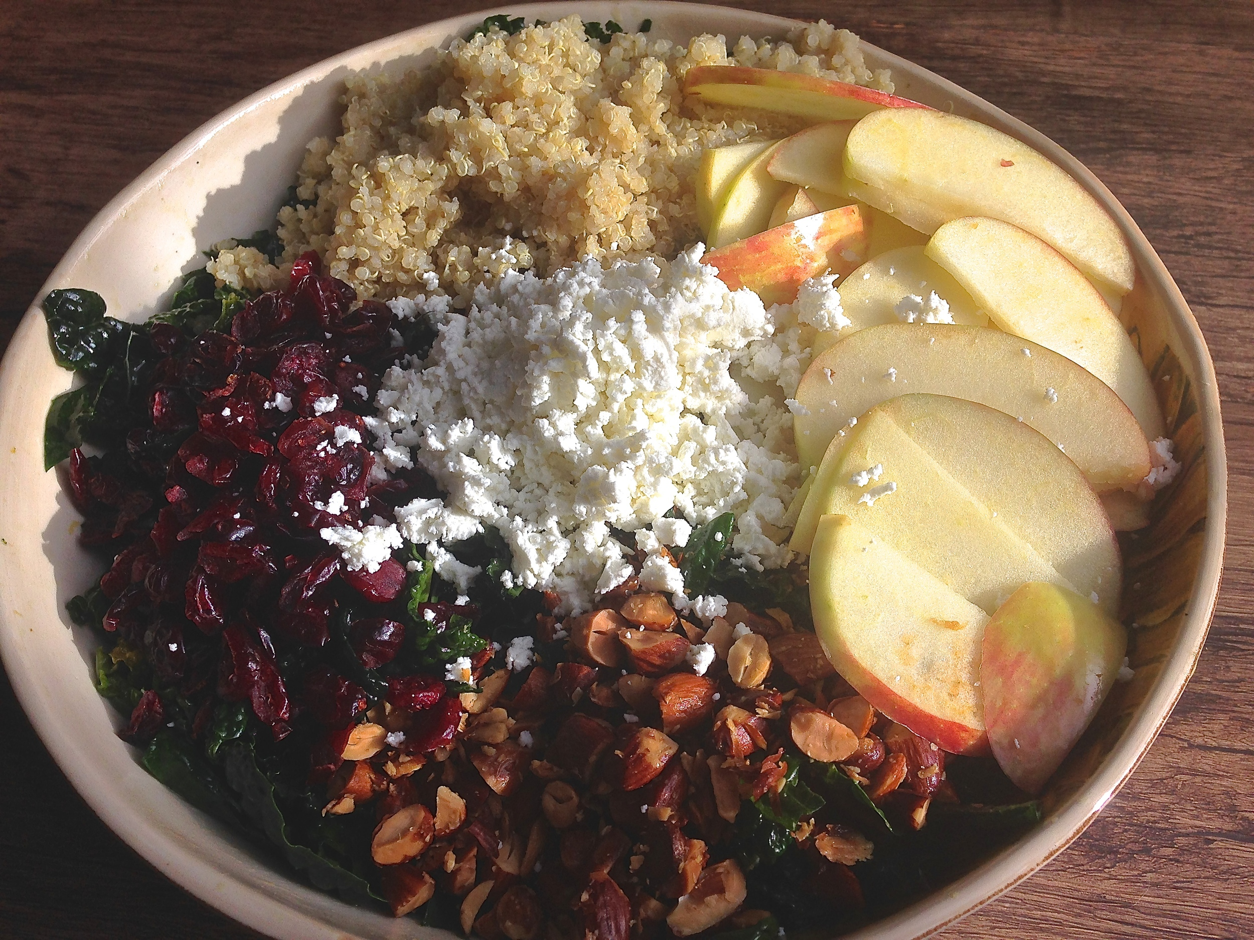 Autumn Kale Salad with Quinoa, Almonds, Cranberries, Apples & Goat Cheese in a Maple Vinaigrette | Kneading Home