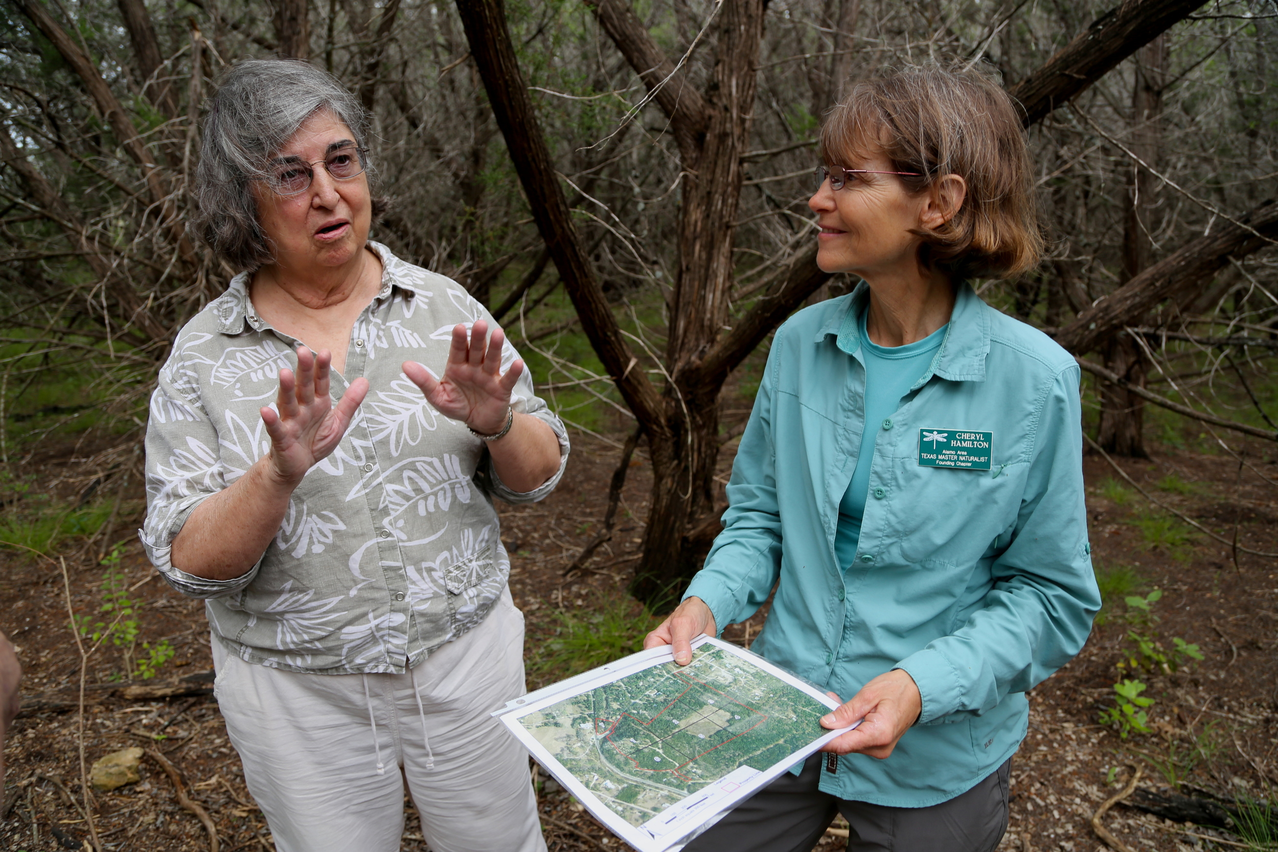 Judith ShockleyandCheryl Hamilton (right) share a map of their work sites.