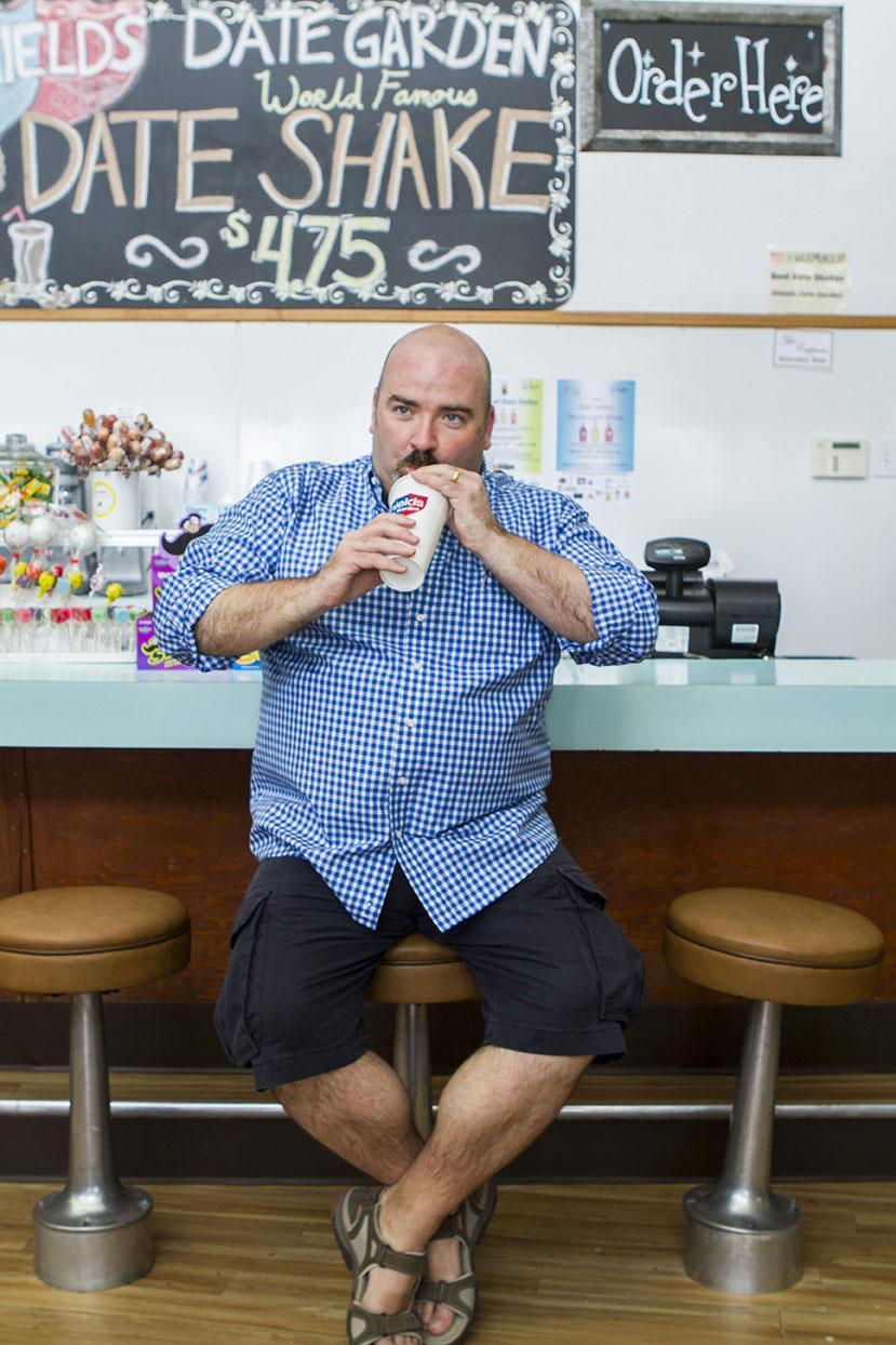 Neil drinks a famous date milkshake