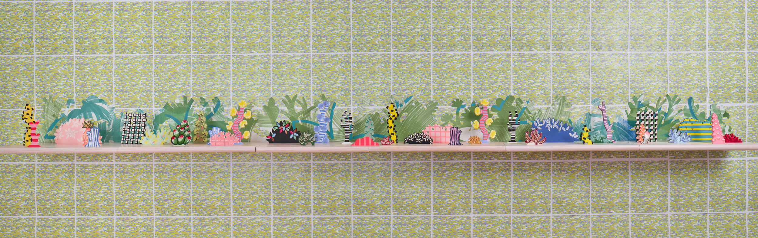 Horizon Allsorts (2018); Six floating wood shelves, painted muslin, ceramic, underglaze and glaze; 12ft x 1ft x 9inches  Installation includes wall paper by Devon Tsuno