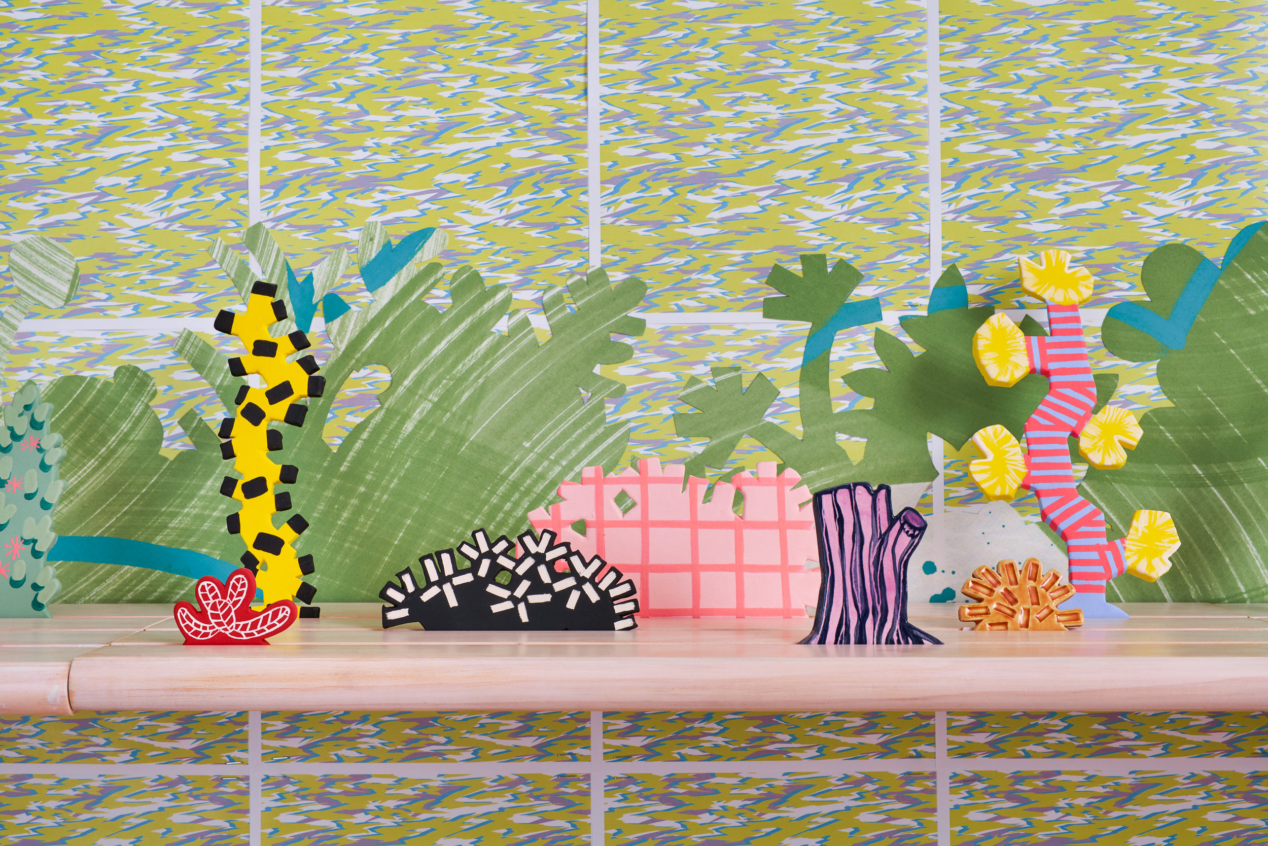 Horizon Allsorts  , 2018 (detail) Six floating wood shelves, painted muslin, ceramic, underglaze and glaze; 12ft x 1ft x 9inches  Installation includes wall paper by Devon Tsuno