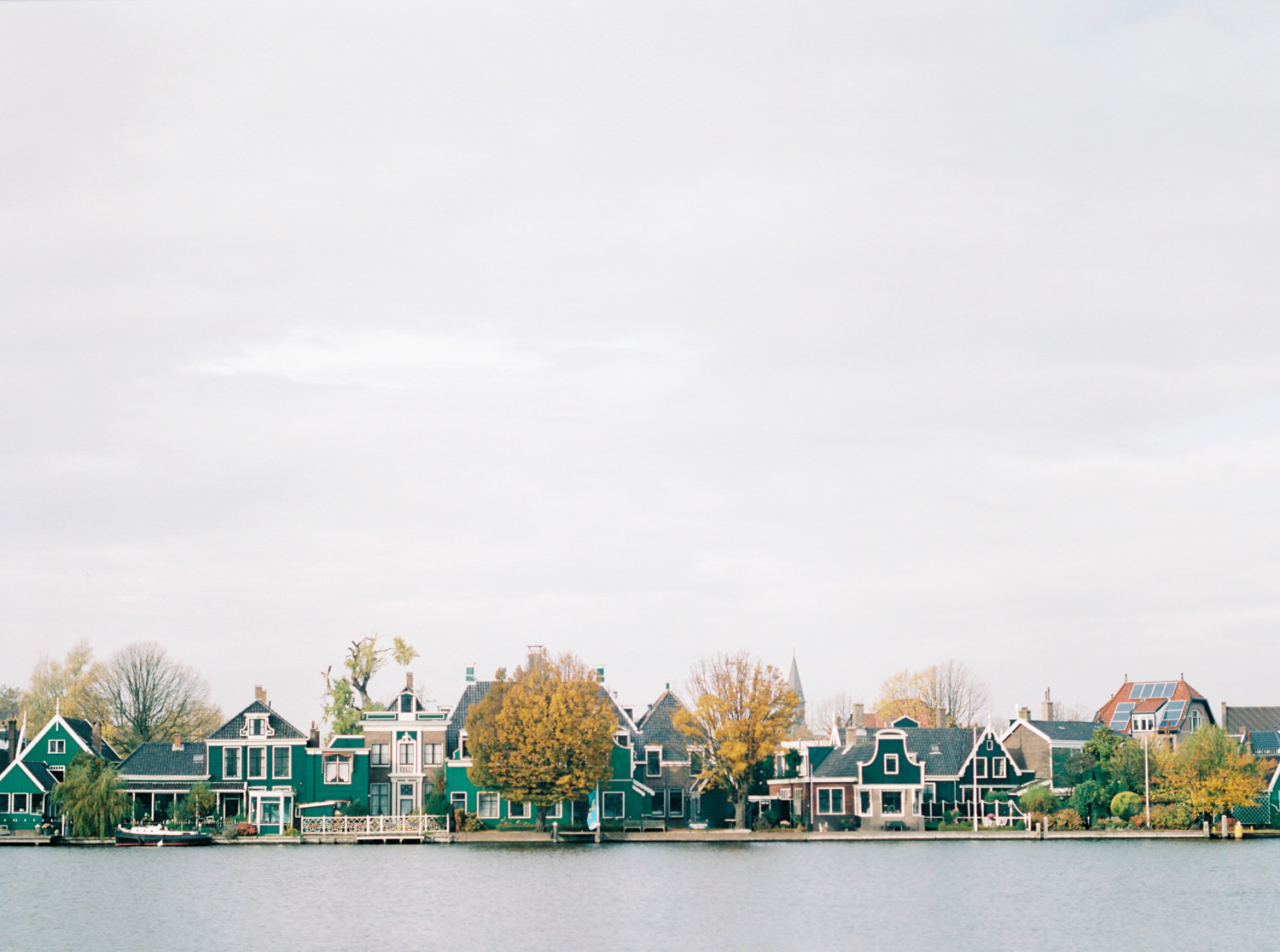 the iconic view of Dutch village Zaanse Schans with its green little houses