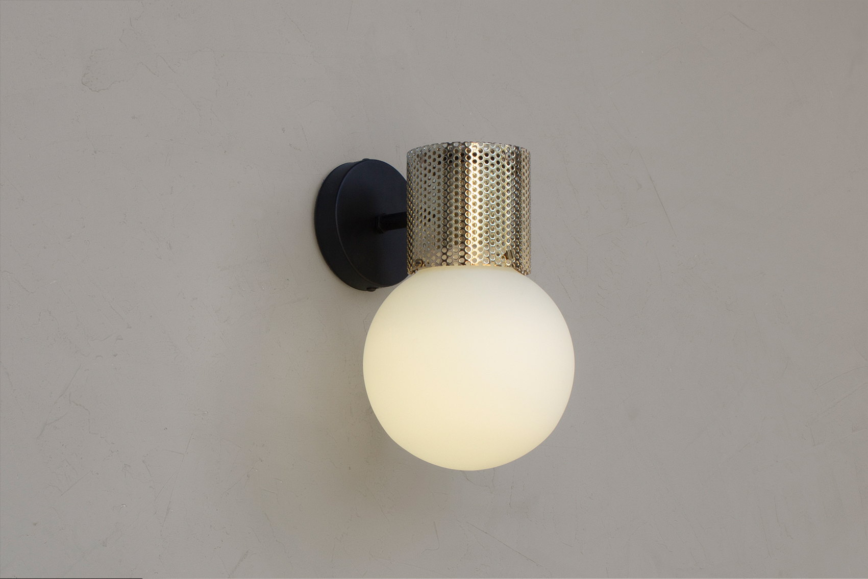 Perf wall sconce in brass -on