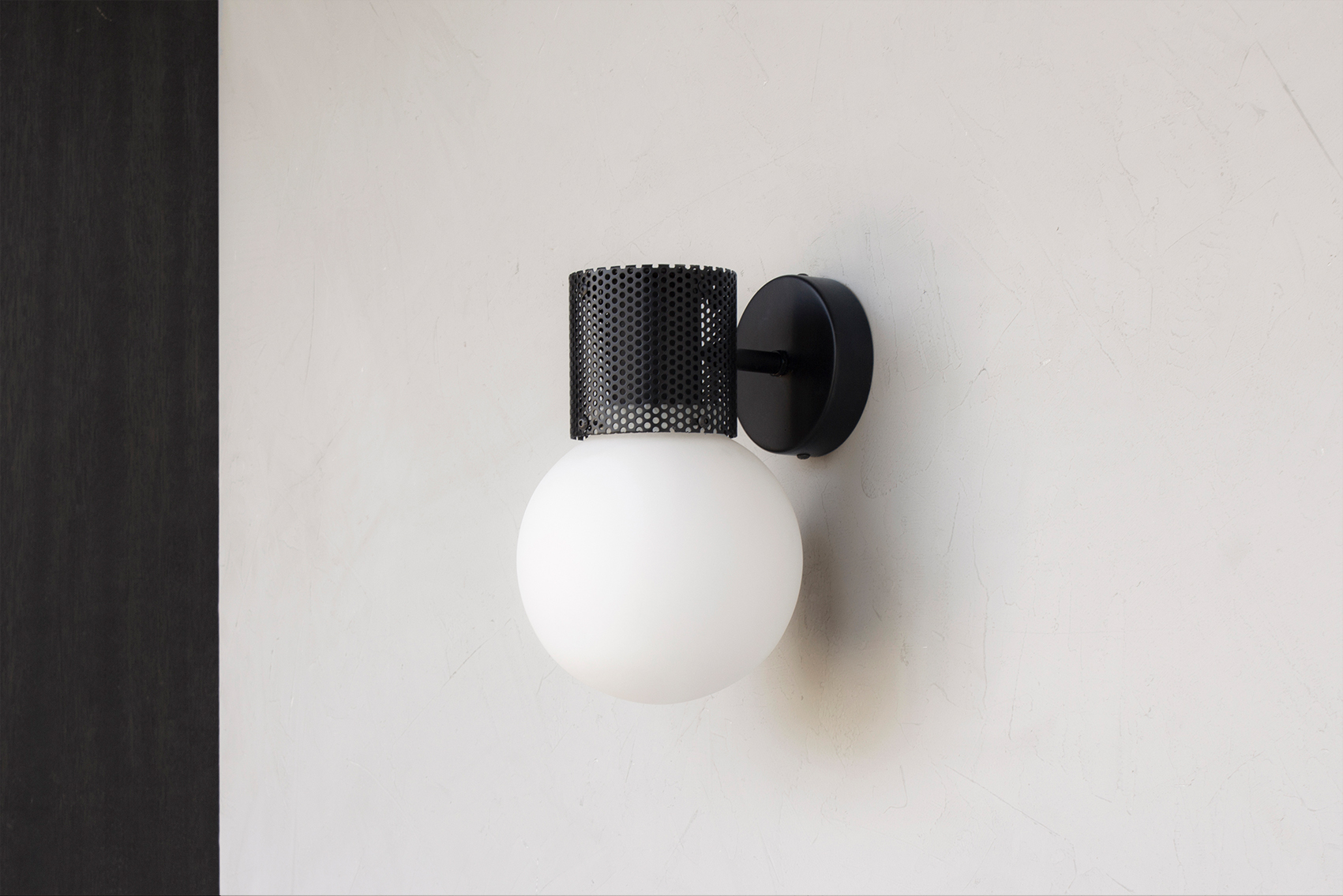 Perf wall sconce in all black