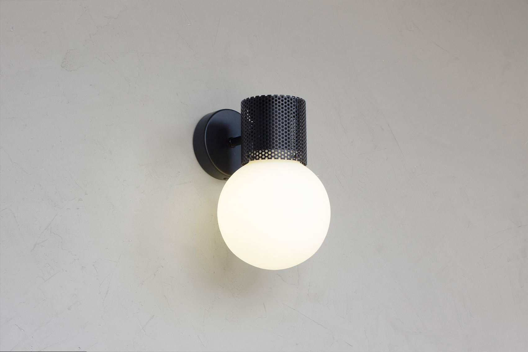Perf wall sconce in all black -on