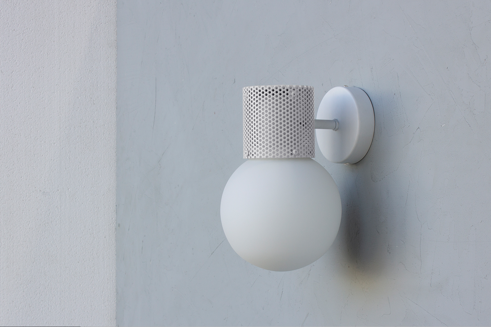 Perf wall sconce in off white