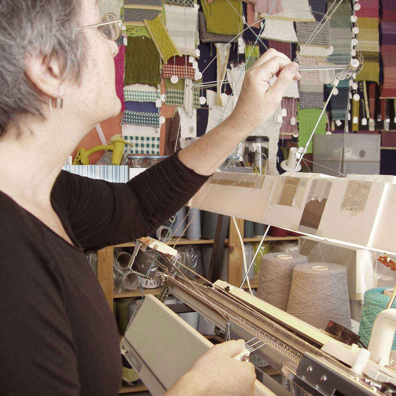 Susan Holton working at her knitting machine