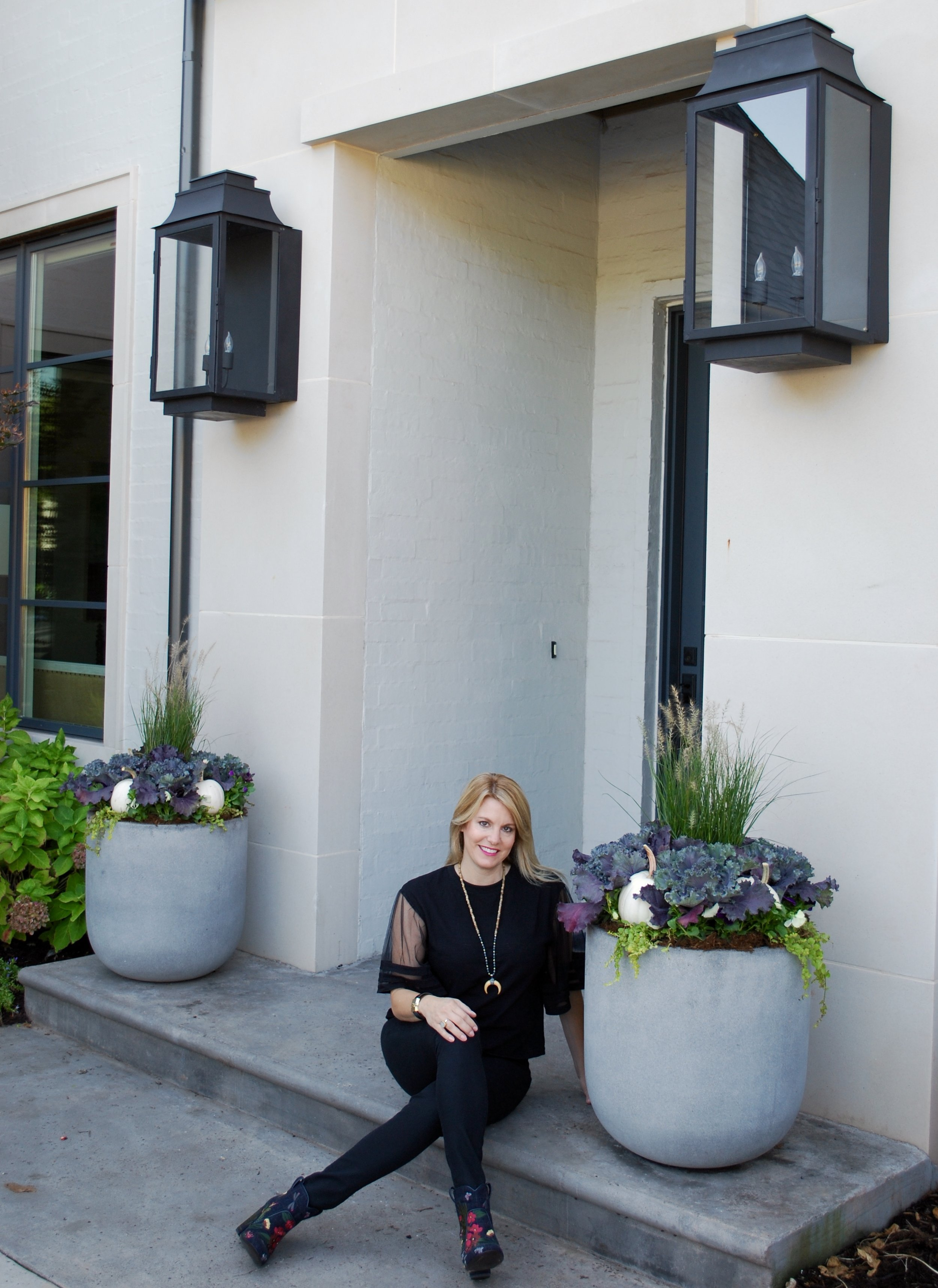 """Curb Appeal Shout Out!   Imagine our delight when we got the call last April from Kristine Bates, an incredible interior designer in OKC, to lend her a hand with her outdoor planters. Her amazing home was going to be on the Nichols Hills Garden Tour and her outdoor pots needed a fresh new look for the summer season. Kristine loves what outdoor planters can add to a back patio. """"Outdoor pots, especially when they are professionally done, can add so much to an outdoor living space. Our covered back patio is an extension of our home and our family spends time there daily. All our living room and kitchen windows look out onto our back patio so we really need our outdoor planters to look fantastic. As a designer, it's important for our house to look """"finished"""" on the inside and out. It's nice to be able to outsource the container gardens to Adorn because I know they will look wonderful all season long. Elizabeth has helped with our planters now for two seasons - summer and fall. I highly recommend her to my clients too.""""  We LOVE digging in the dirt at her beautiful home! Kristine's firm, Kristine Bates Interiors, does everything from updating to designing complete house plans starting from the ground up to final completion. She is SO talented and we are thankful for the opportunity to work with her and her team on a seasonal basis."""