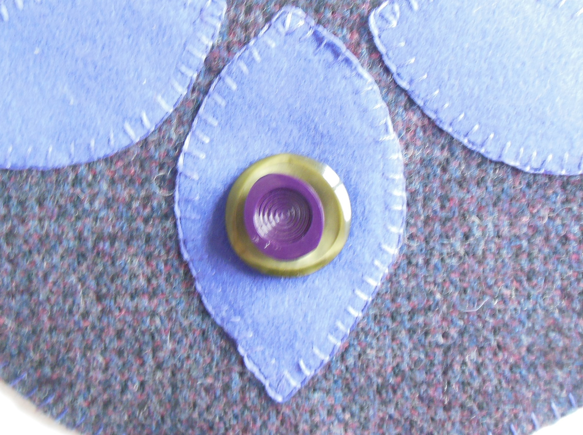 Embellishing with Green and Purple Buttons.  Irregular Nile green with shanked Purple button sewn on top.