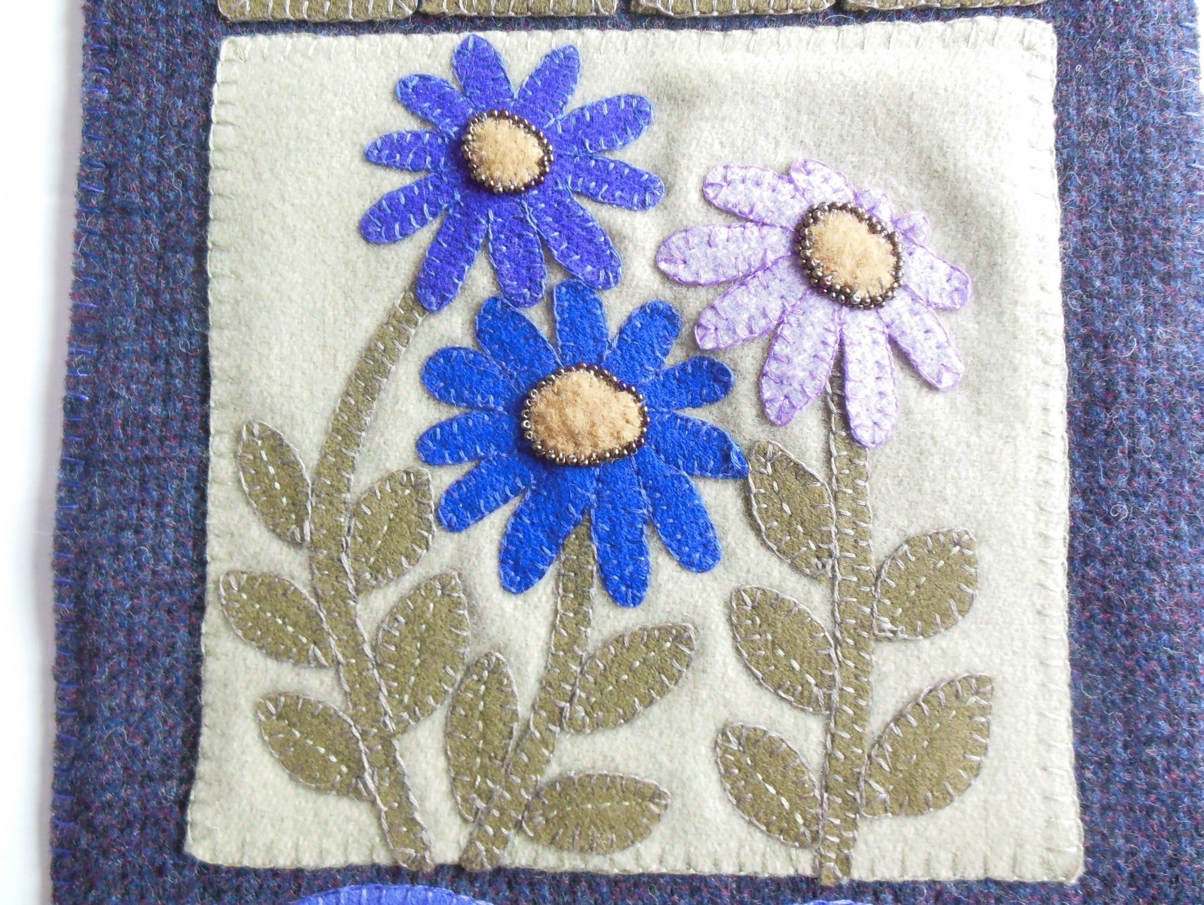 I replaced the French Knots with beads.