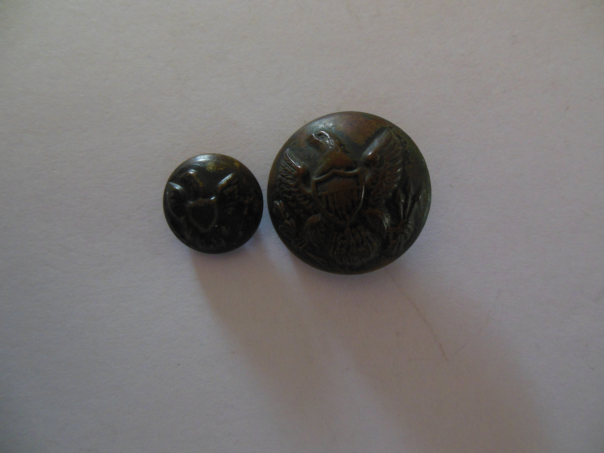 General Service Buttons 1850s to 1902. The larger of the two buttons has rust on the back and will need to be cleaned and preserved.