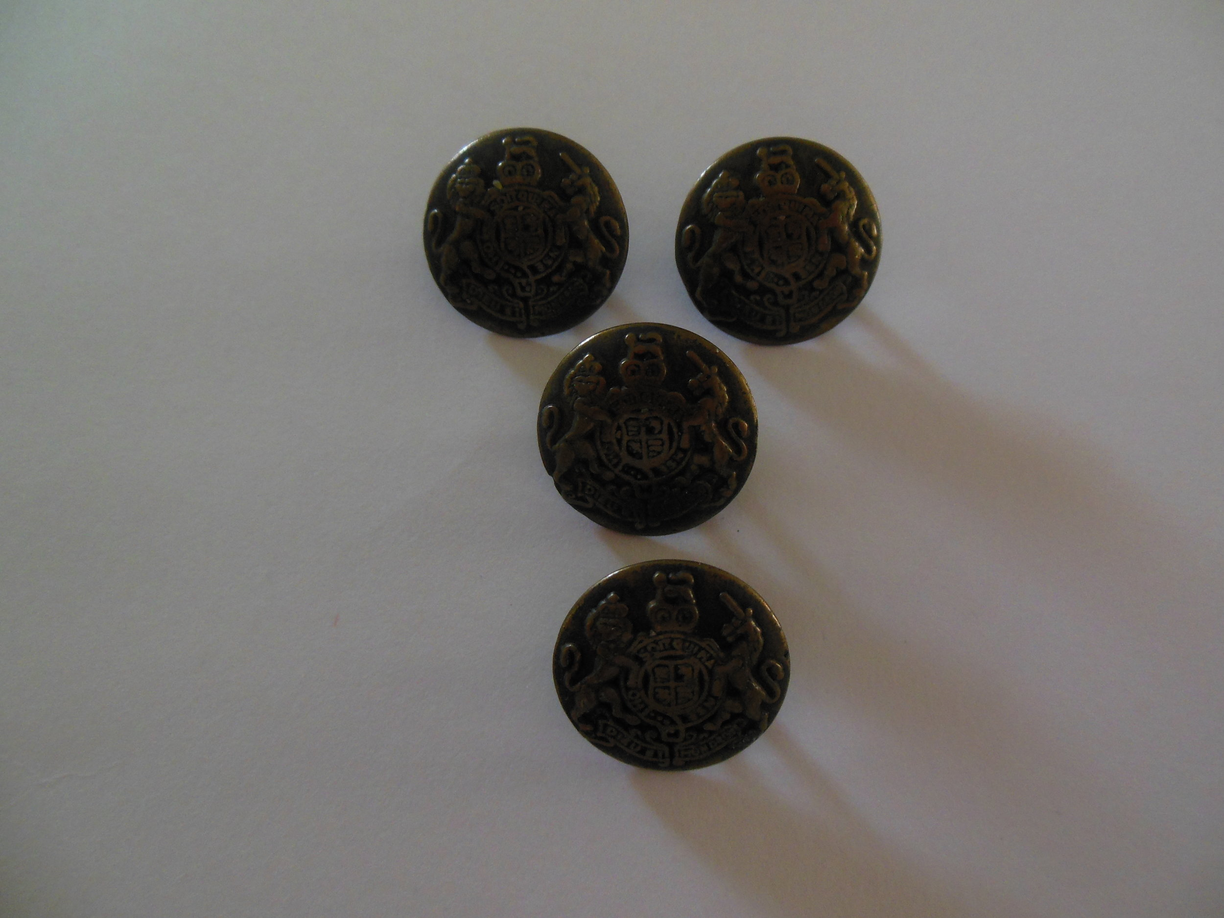 British Army Buttons with the Royal Crest showing a lion and unicorn.