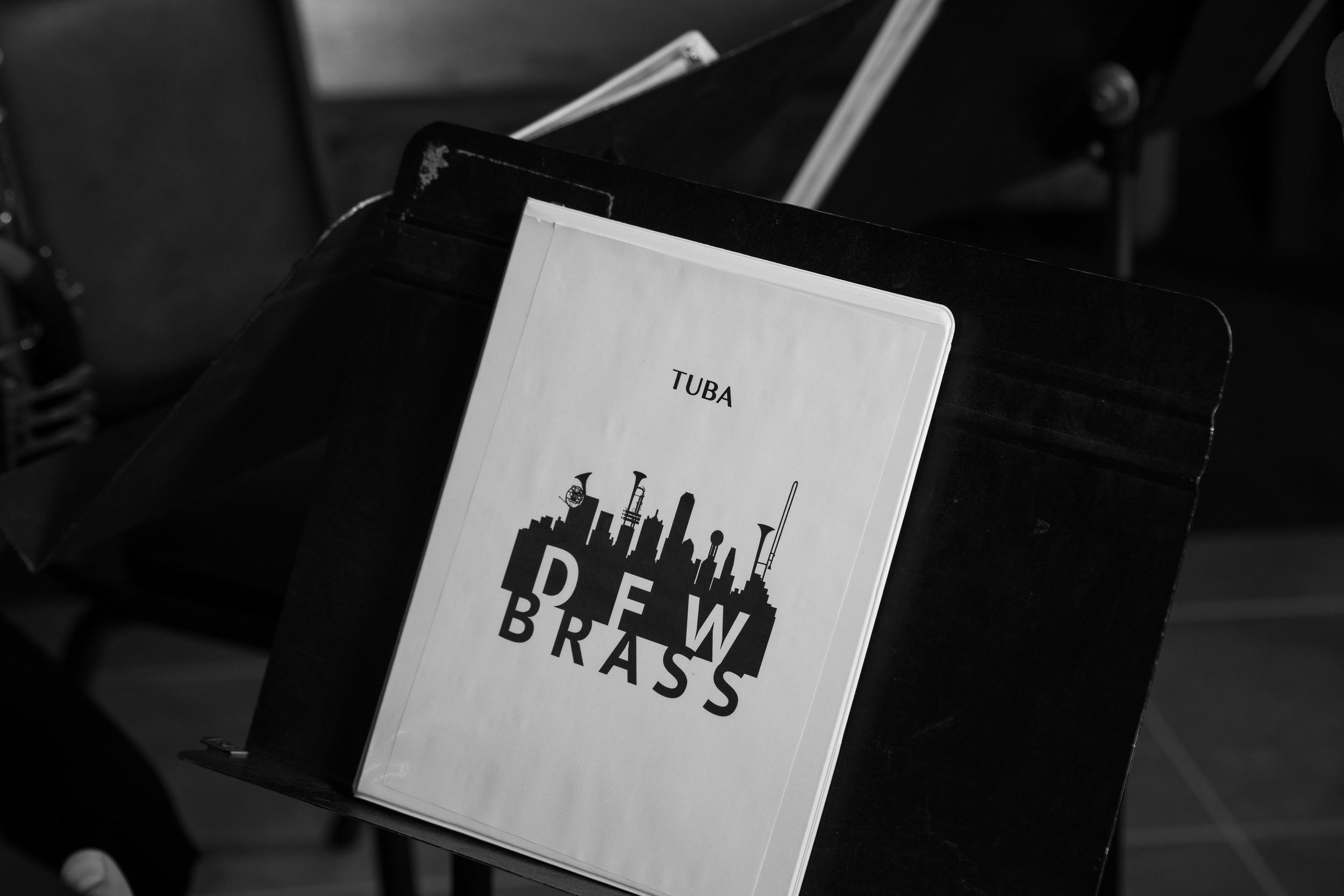 folder on stand with DFW Brass logo.jpg