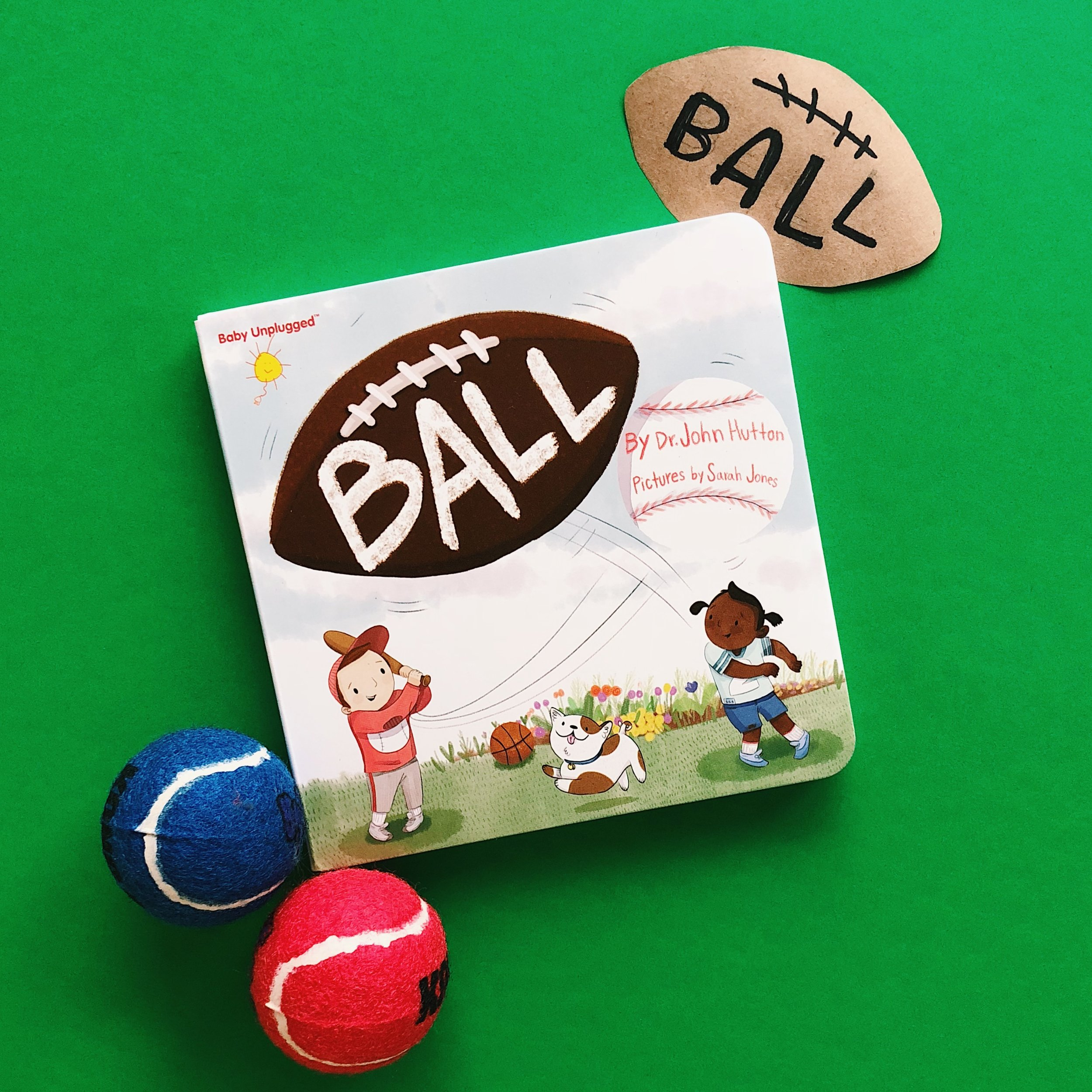 """Throw ball, catch ball, go ball, fetch ball!"" -   Ball  , written by Dr. John Hutton and pictures by Sarah Jones"