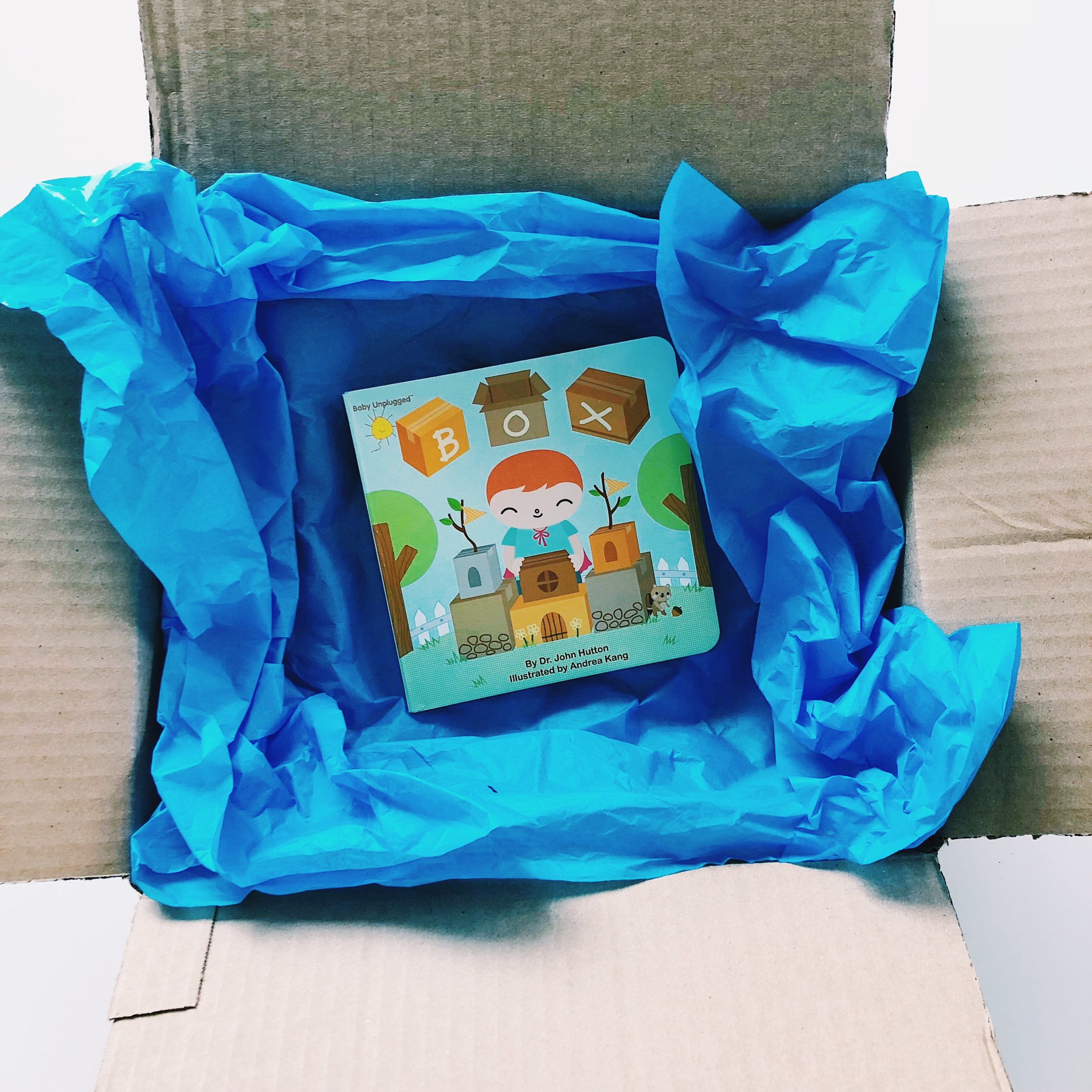 """Gifts are nice—shoes, toys, and dolls. Boxes are the best of all!"" -   Box  , written by Dr. John Hutton and illustrated by Andrea Kang"