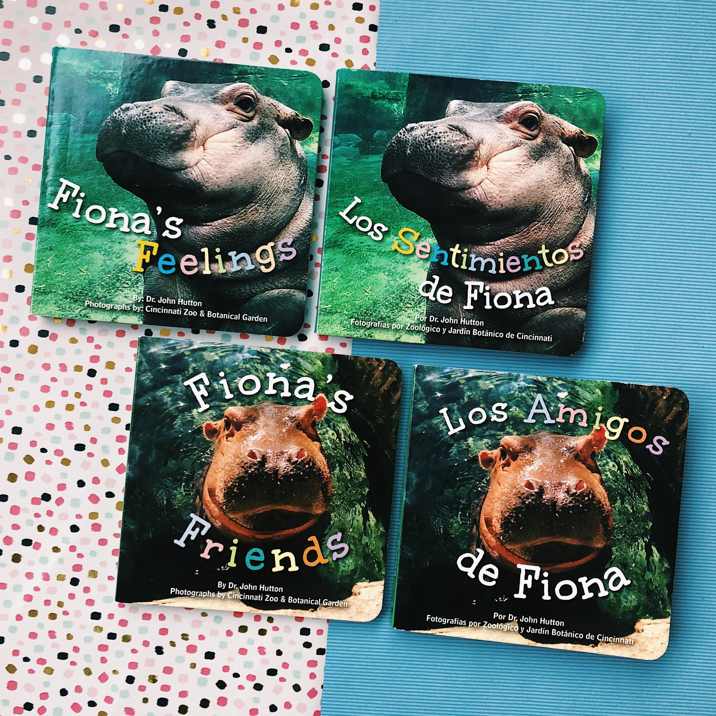 Fiona's Feelings   and   Fiona's Friends   written by Dr. John Hutton and photographs provided by the Cincinnati Zoo & Botanical Garden ;   Los Sentimientos de Fiona   and   Los Amigos de Fiona   on sale spring 2019