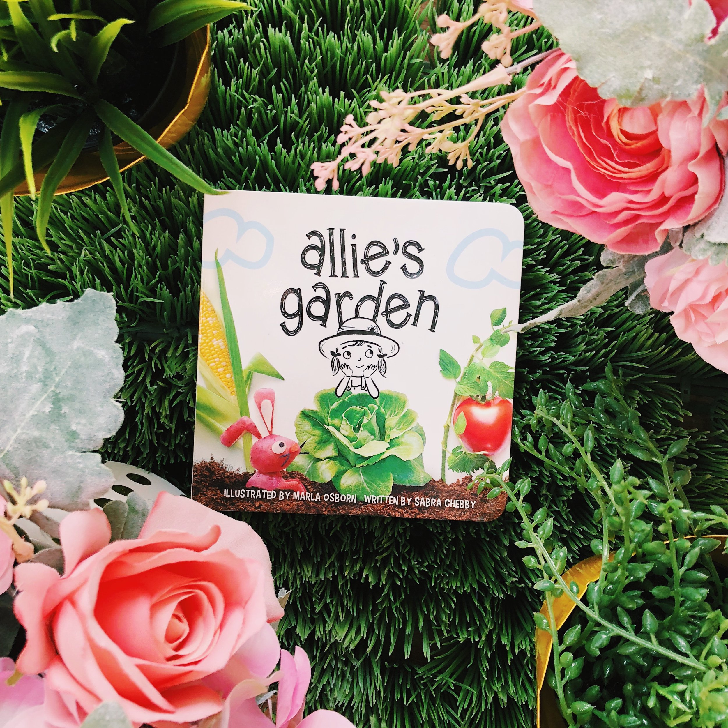 Pretty flowers, soft grass, and   Allie's Garden   makes for the perfect summer afternoon!