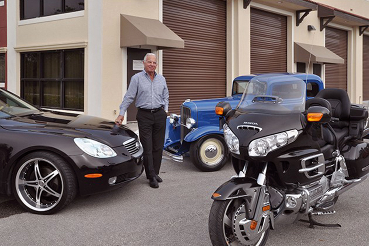 Phil Pugh  of Pugh Realty Group says luxury storage condos are in demand because people are looking for a secure place to store their expensive vehicles and other valuables.  - Photo by Ed Clement