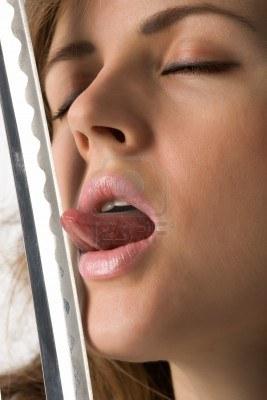 3941629-beautiful-girl-with-close-eyes-licks-cutting-edge-of-sword