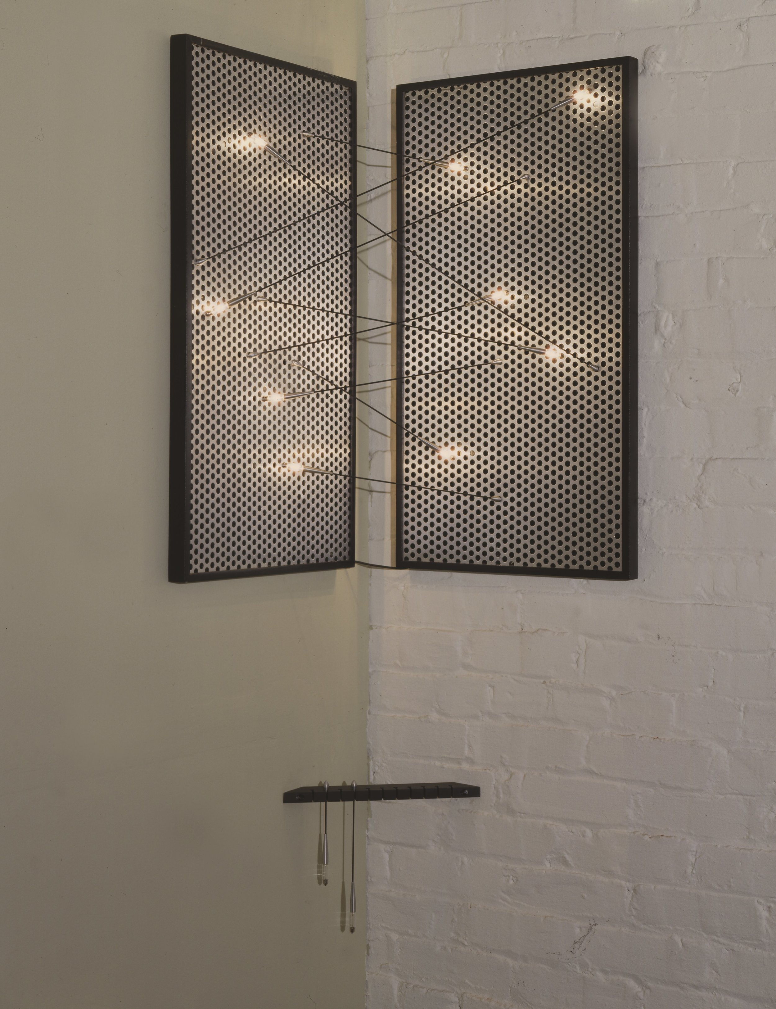 """Quiver"" has a rack of Festoon light bulb tipped arrows which the user may place in a sculptural configuration between the two electrified perforated aluminum panels."